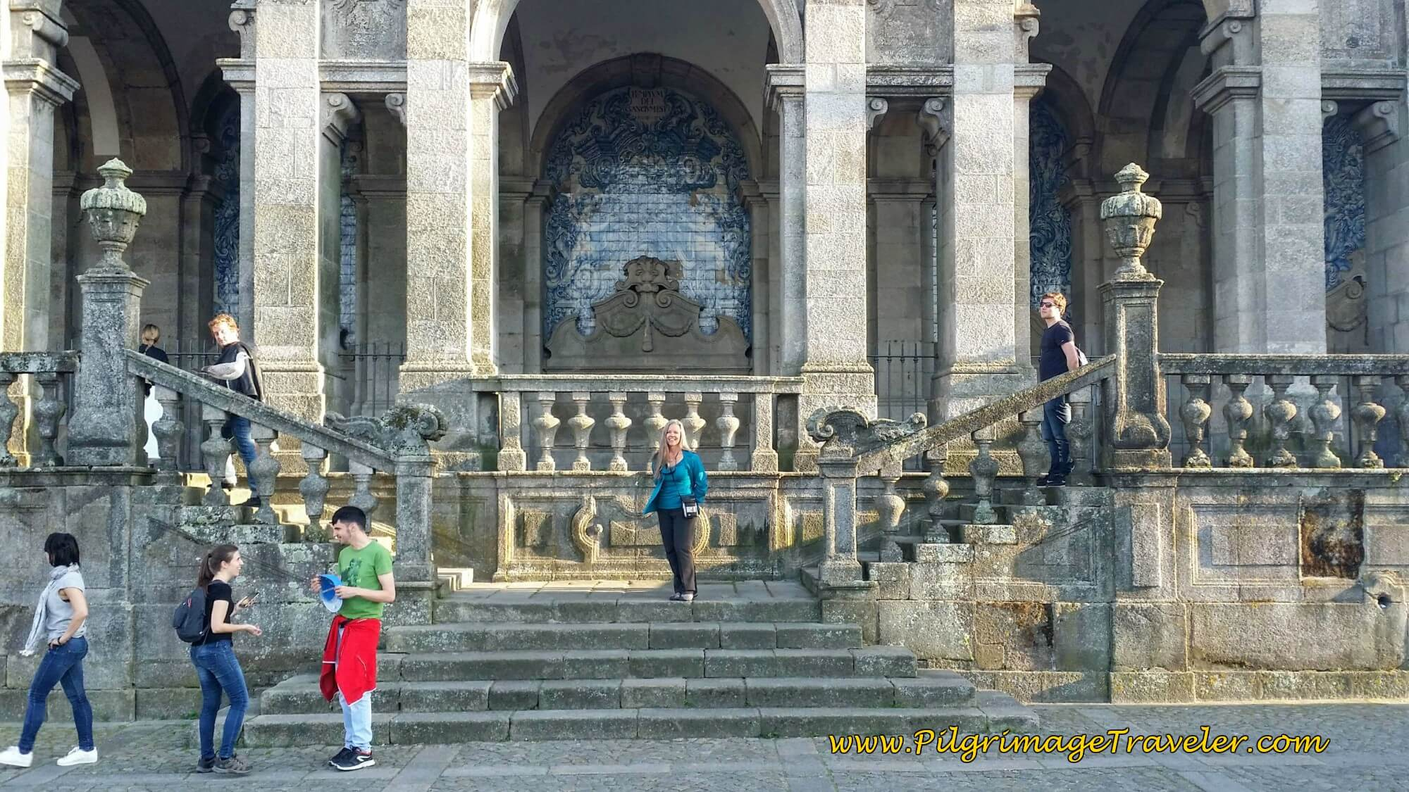 Elle at the North Façade of the Cathedral of Porto with Azulejo Murals on day fourteen of the Camino Portugués