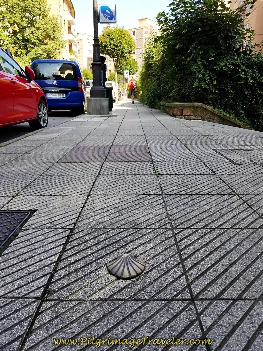 Shell Waymark Along Calle Leopoldo Alas in Oviedo on day six of the Camino de San Salvador