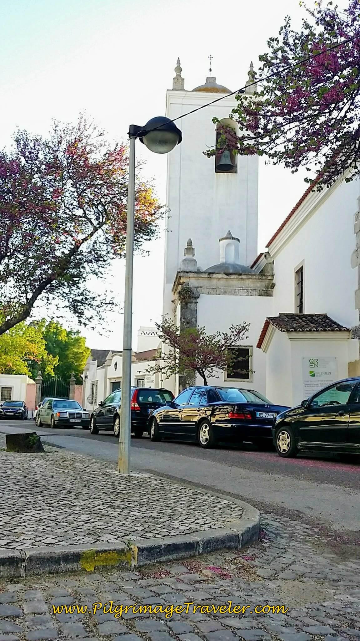 Small Yellow Arrow on Curb by the Church in the Largo do Alcáçova, Santarém, Portugal