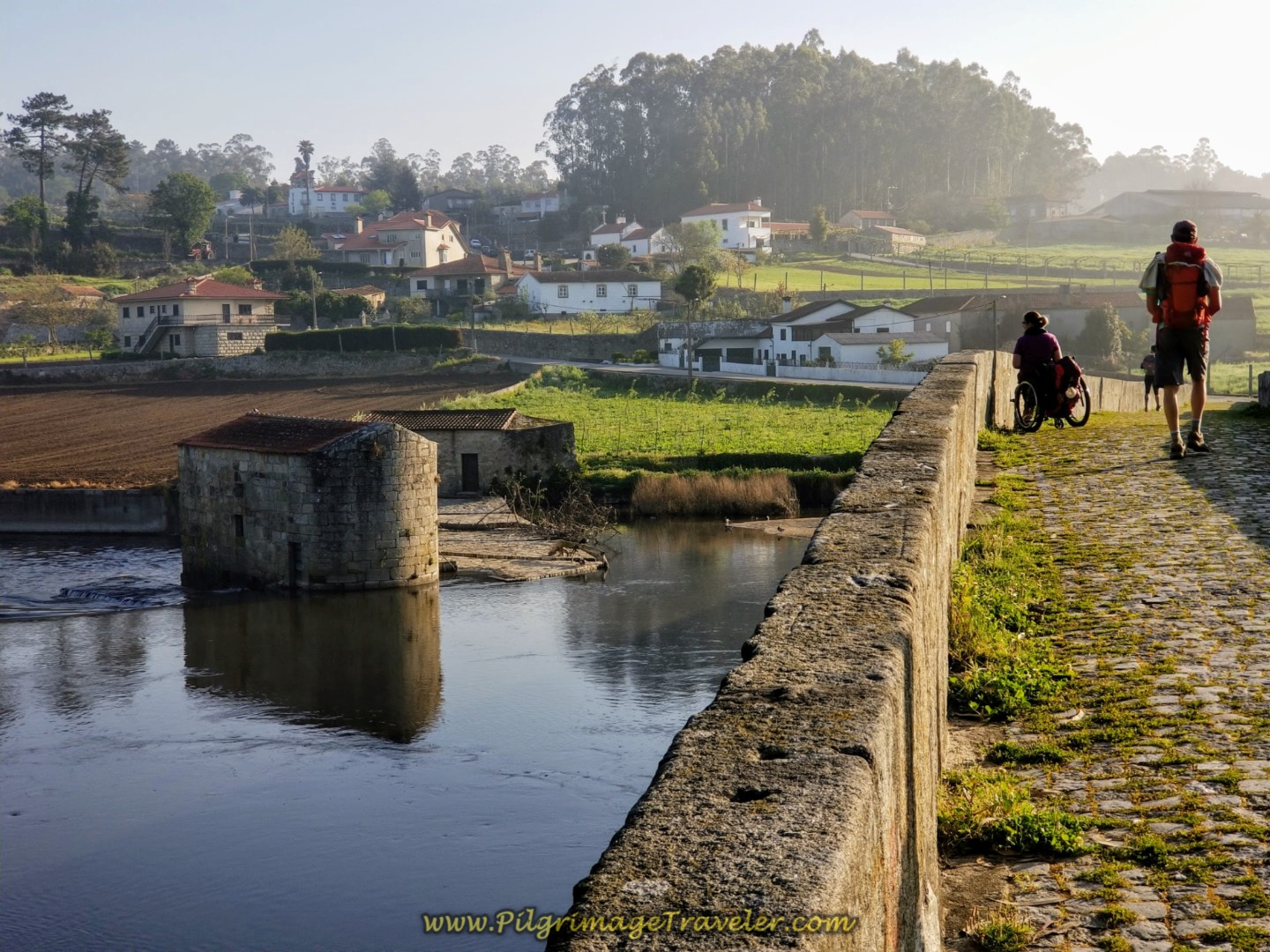 Magdalena Gazes Into the Water at the Ponte D. Zameiro, in Ponte do Ave, Portugal on the Central Route of the Camino Portugués