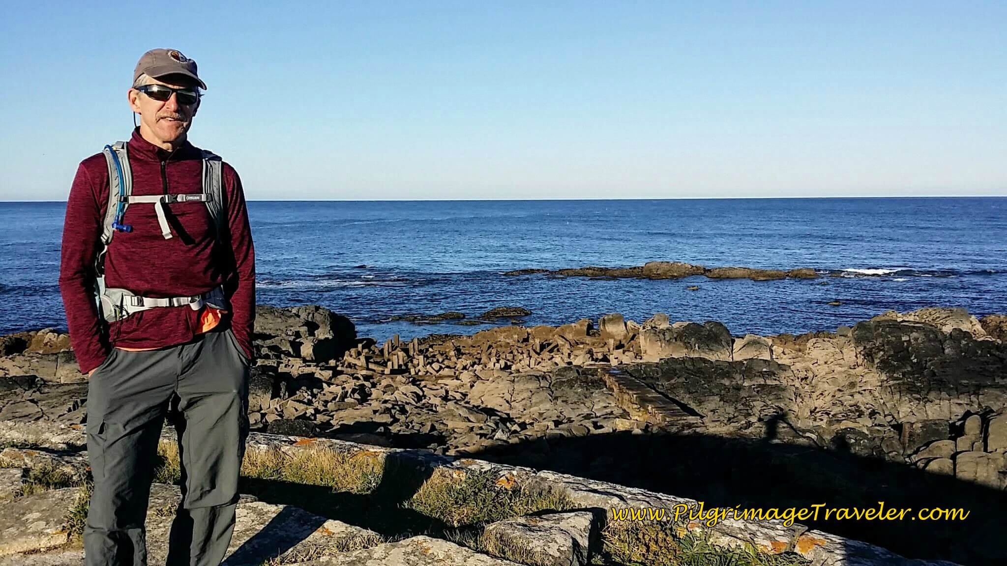 Rich on the Seaward Wall of the Forte de Rego de Fontes on day eighteen of the Camino Portugués on the Senda Litoral