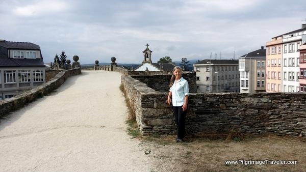 Elle on the Roman Wall in Lugo, Spain