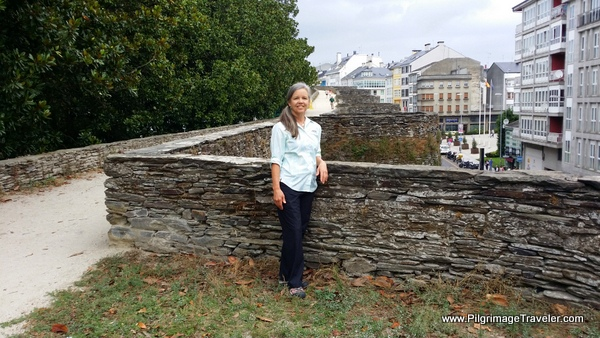 Elle on the Roman Wall in Lugo, Spain