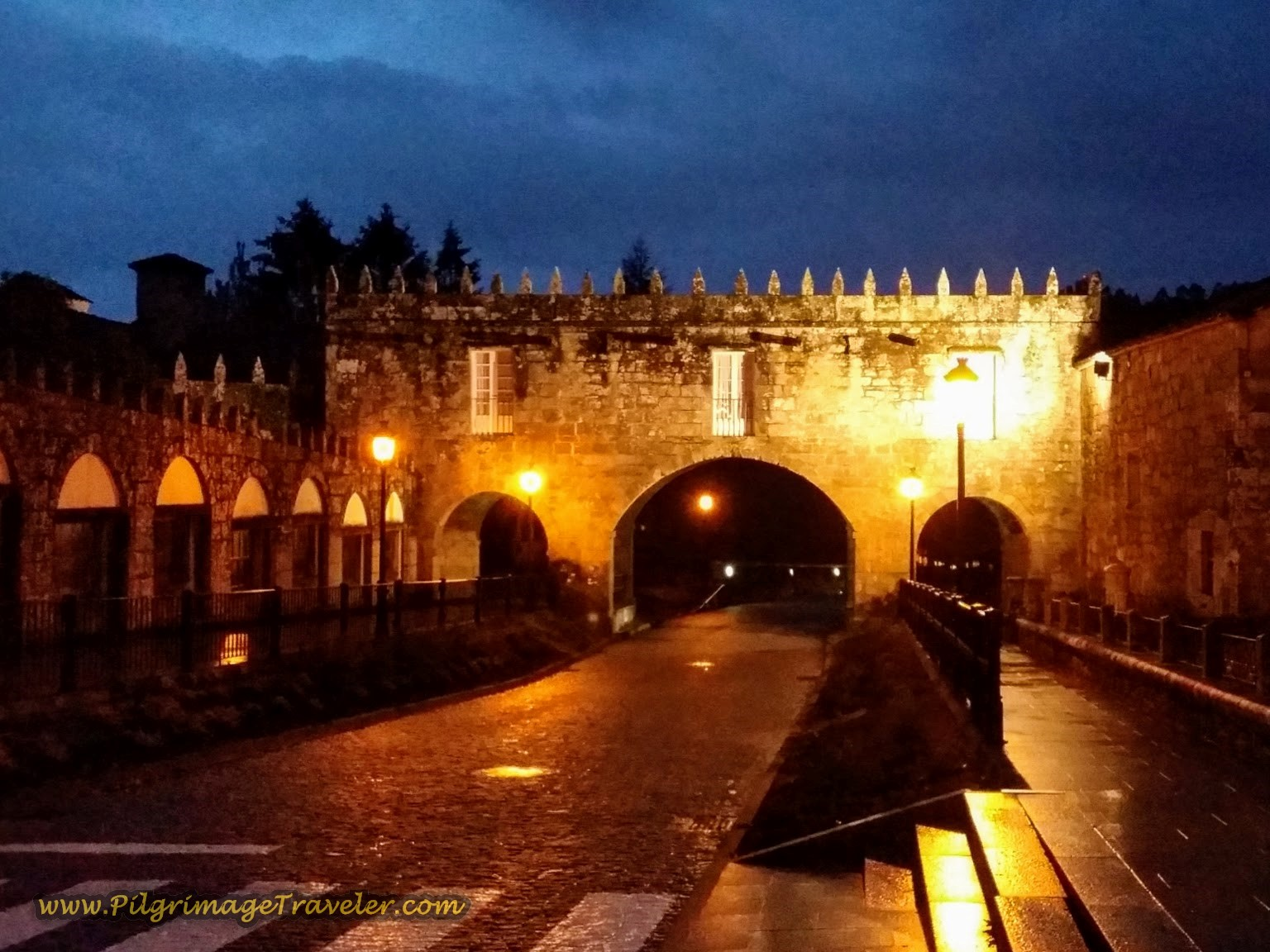 Leaving Negreira through the Pazo do Cotón medieval gate, just before sunrise on day two of the Camiño Fisterra