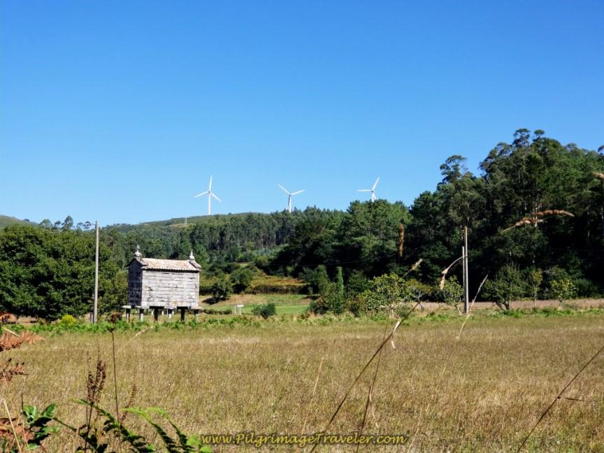 Quaint Hórreo in a Field with Windmills Near Dumbría