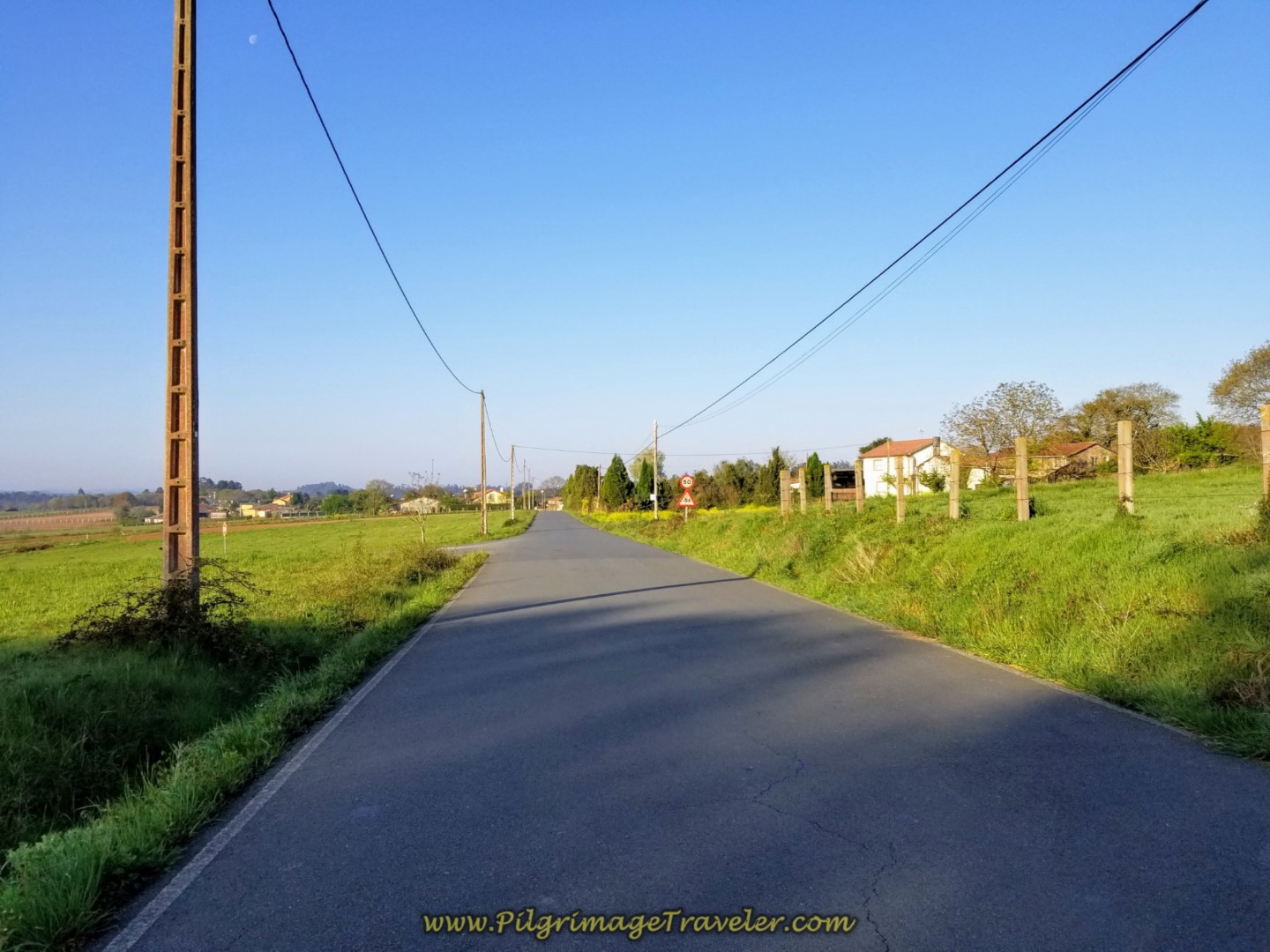 Long Paved Road Towards A Rúa on day seven of the Camino Inglés