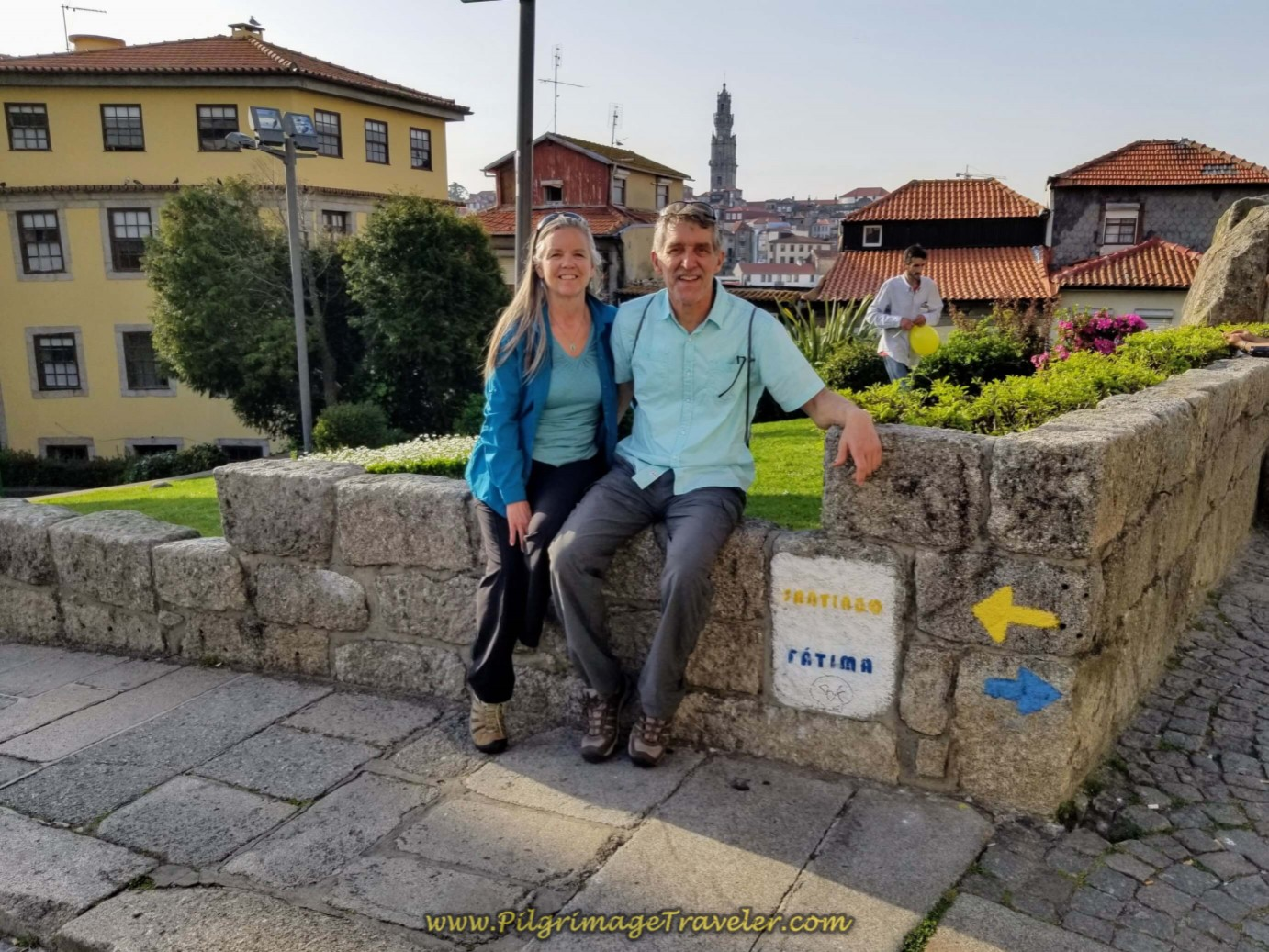 Rich and Elle at First Yellow Arrow Across from the Cathedral in Porto on day fifteen on the Central Route of the Camino Portugués