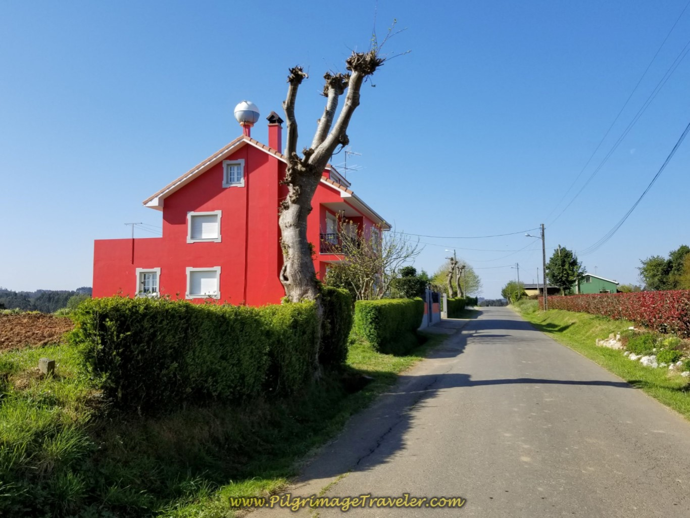 Distinctive Red House, Leaving A Calle on day seven of the English Way