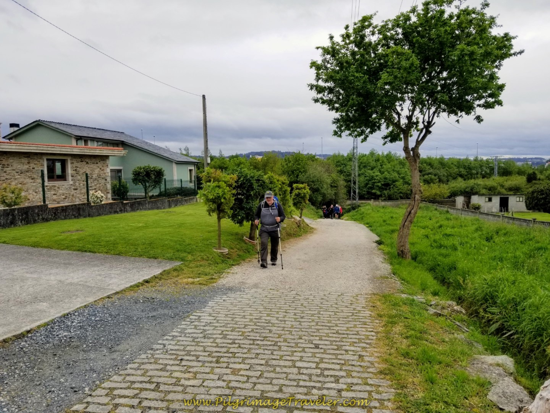 Steve Climbing on the Camiño da Fonte do Vilar Path on day one of the Camino Inglés