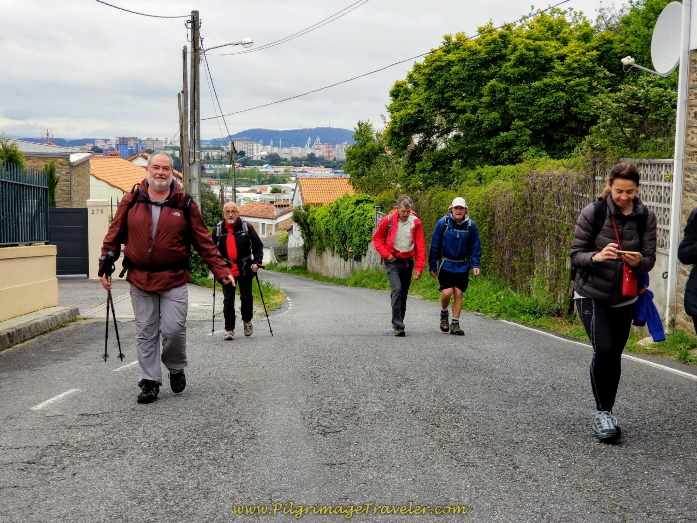 Pilgrims on the Steep Climb Up the Camiño do Vilar Street on day one of the Camino Inglés