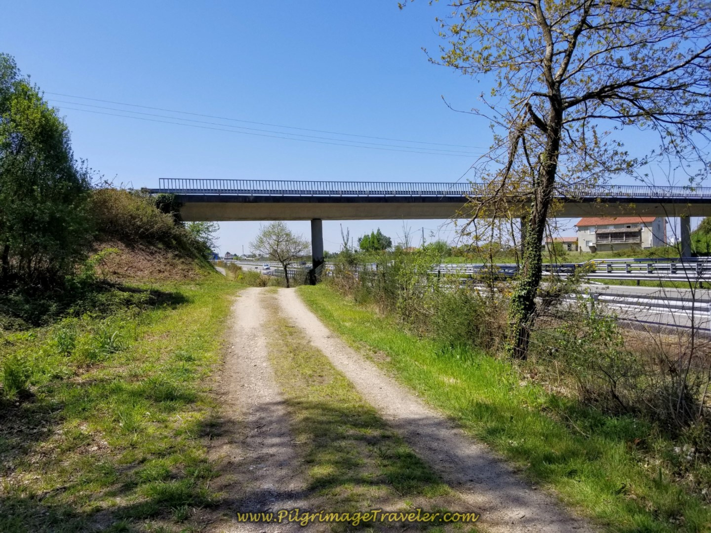 Continue on E-1 Frontage Lane Under Bridge on day seven of the English Way