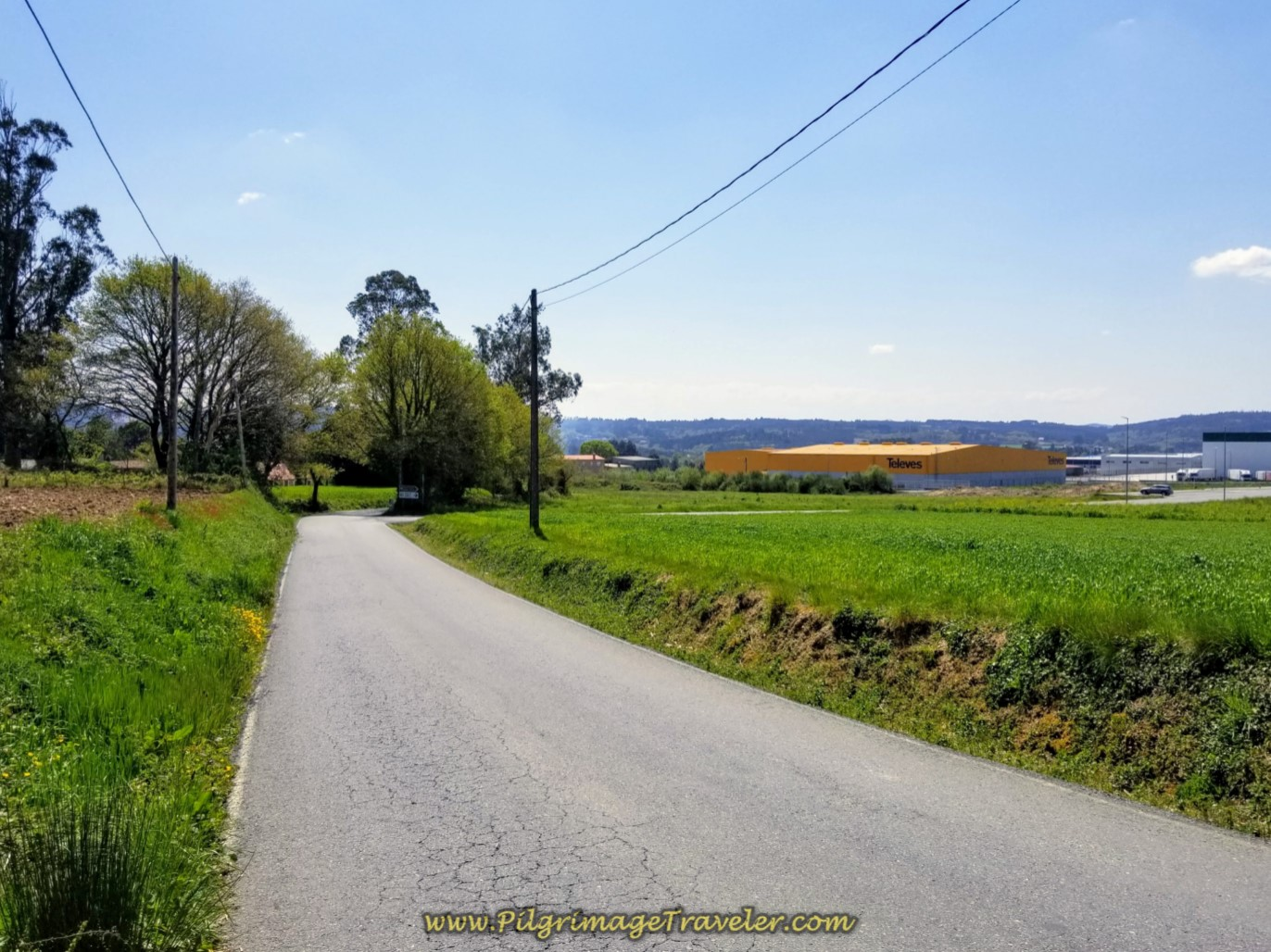 Left Turn from the E-1 Onto Long, Hot Pavement toward Industrial Park of Sigüeiro on day seven of the English Way