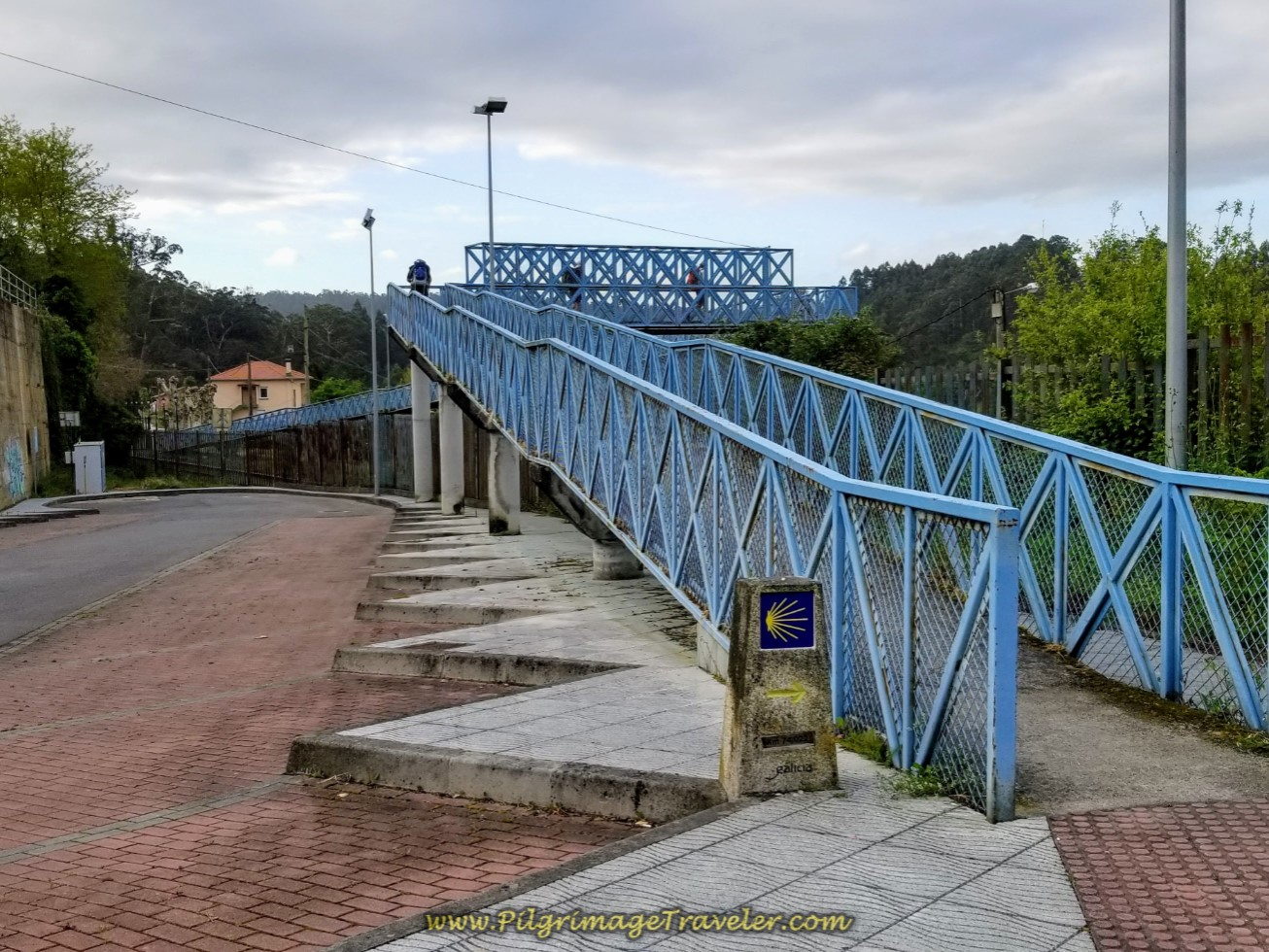Camino Takes the Blue Pedestrian Bridge Across the Railroad tracks on day four of the Camino Inglés