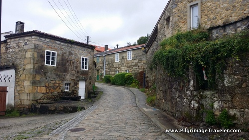Camino Finisterre through the town of Ponte Maceira, Galicia, Spain