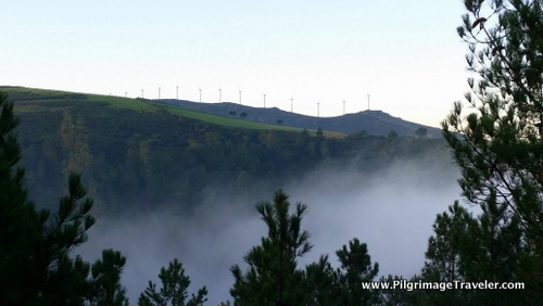 Windmills and Clearing Clouds on the Finisterre Way, from Olveiroa, Spain